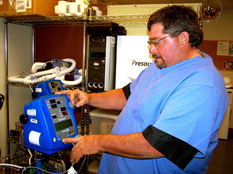 – Greg Bose, ET Program Biomedical Intern at GCRMC, tests a physiological monitor unit after performing preventive maintenance and calibration procedures.