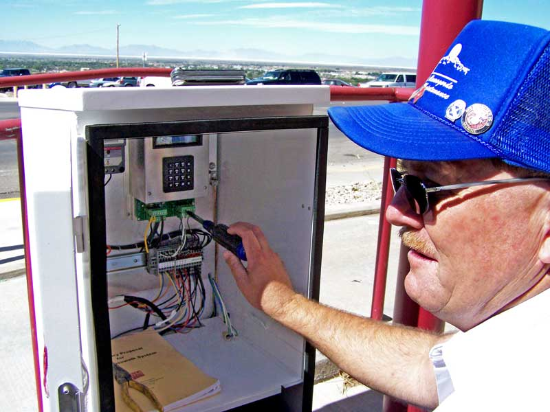 -Larry Gardner from the city of Alamogordo and a NMSU-A ET Program Electronics Technology graduate works on the NMSU-A Smart Crosswalk